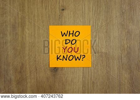Who Do You Know Symbol. Yellow Sheet Of Paper. Words 'who Do You Know'. Beautiful Wooden Background.
