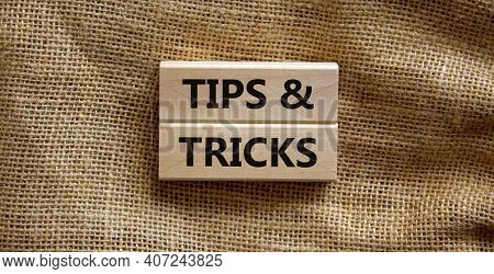 Tips And Tricks Symbol. Wooden Blocks With Words 'tips And Tricks'. Beautiful Canvas Background. Bus