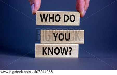 Who Do You Know Symbol. Businessman Hand. Wooden Blocks With Words 'who Do You Know'. Beautiful Grey