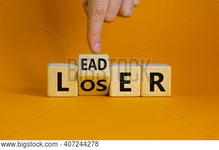 From Loser To Leader Symbol. Businessman Turns A Wooden Cube And Changes The Word 'loser' To 'leader