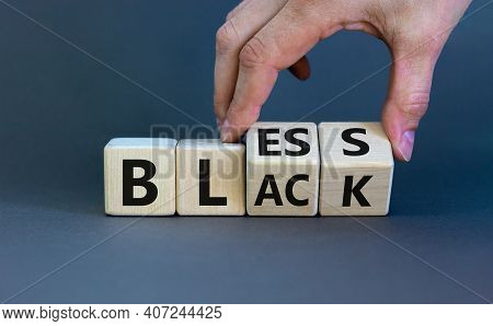 Bless Black Symbol. Hand Flips A Cube And Changes The Word 'black' To 'bless'. Beautiful Grey Backgr