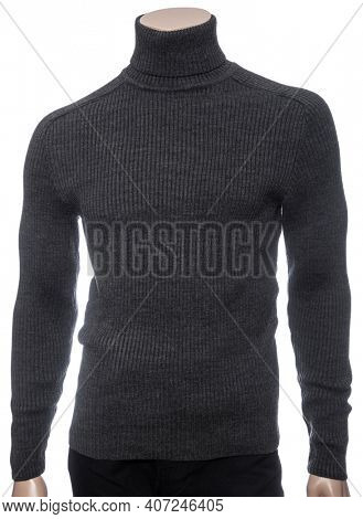 Grey knitted longsleeve polo neck jumper on mannequin isolated on a white background