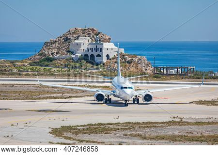 Plane Landing On Island Airport. European Low Cost Airline Airbus A320 Aircraft Departing Internatio