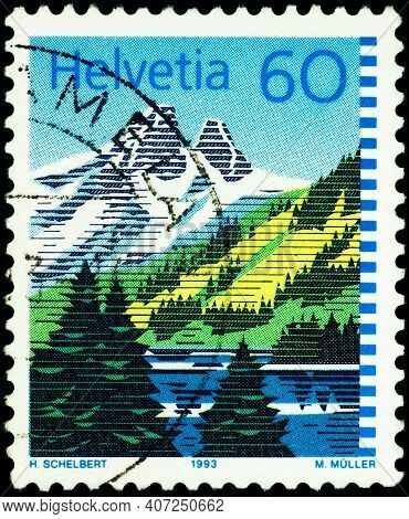 Moscow, Russia - February 08, 2021: Stamp Printed In Switzerland Shows Mountain Lake, Lac De Tanay I