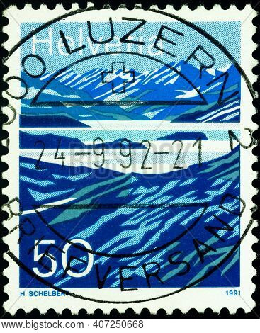 Moscow, Russia - February 08, 2021: Stamp Printed In Switzerland Shows Laghetto Moesola, Lake On San