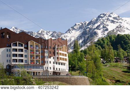 Krasnaya Polyana, Russia - May 15, 2019. Nice View Of The Snow-capped Mountains Of The Caucasus And