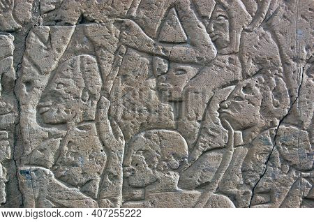An Ancient Egyptian Relief Carving Of Nubians, About To Be Slaughtered By The Pharoah Ramses Ii. Car