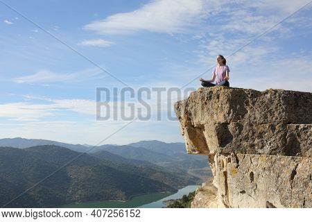 Yogi Doing Yoga Exercise Meditating In The Top Of Cliff In The Mountain With A Beautiful Landscape I