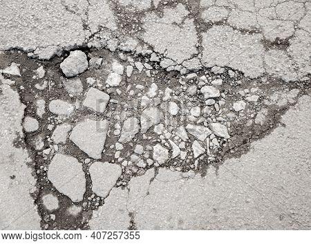 Large Pothole With Stones On The Asphalt Highway