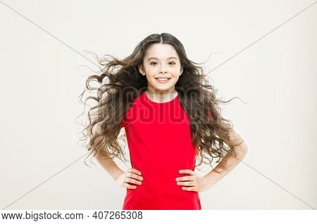 Feeling Beautiful. Fashion Baby Girl. Cute Little Fashion Model On Yellow Background. Small Child Wi