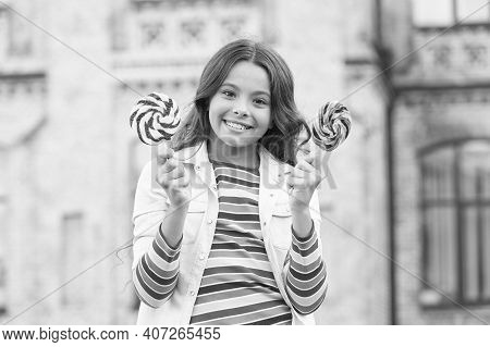 Yummy-yummy. Small Girl Has Curly Hair. Spring Holiday Mood. Little Beauty In Positive Mood. Childho