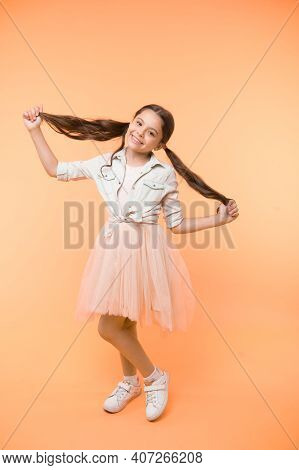 Long Hair Tips For Kids. Kid Girl Charming Ponytail Hairstyle Cute Happy Yellow Background. Child St
