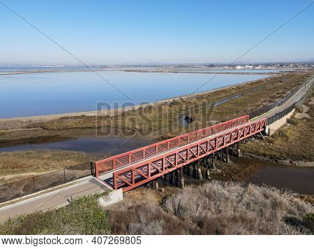 Aerial View Of Small Bridge On Otay River Next To San Diego Bay National Refuger In Imperial Beach,