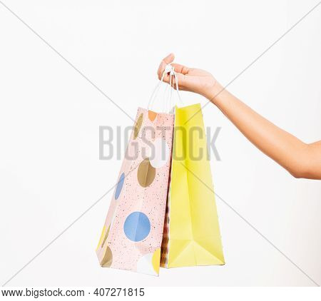 Closeup Women Hand Holding Colorful Multicolor Shopping Bag Many Packets Isolated On White Backgroun