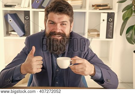 My Energy. Man Handsome Boss Sit In Office Drinking Coffee. Comfy Workspace. Good Morning. Bearded H