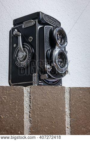 Zurich, Switzerland - December 31, 2020: Isolated Twin Lens Reflex Retro Camera Minolta Autocord On