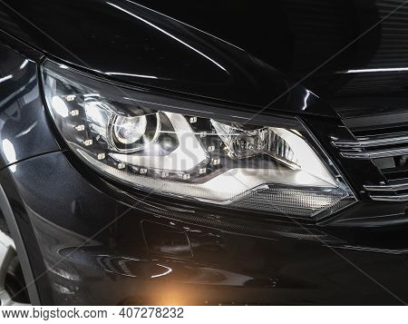 Novosibirsk, Russia - February 07 2021: Volkswagen Tiguan, Headlight Of A Modern Popular Car Close-u