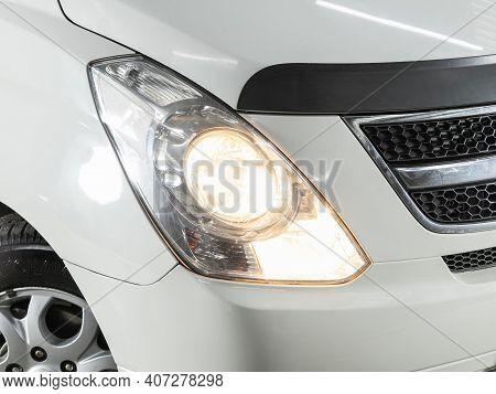 Novosibirsk, Russia - February 07 2021: Hyundai Starex, Headlight Of A Modern Popular Car Close-up.