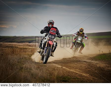 Constanta, Dobrogea, Romania - August 21 2020: motocross bike racers competing for leadership at 4V Rally Raid, speed and power in extreme man sport , sport action concept