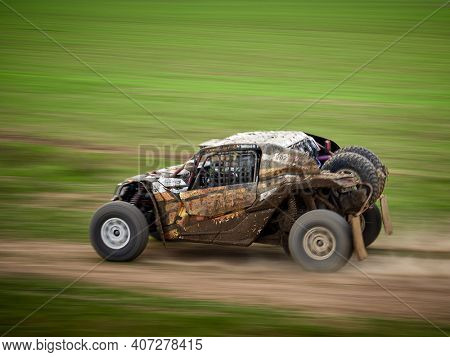 Constanta, Romania - August 21, 2020: 4x4 cars competing for leadership at the 4V Rally Raid, dinamic image of car speeding on the green field