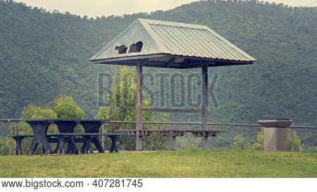 A Dilapidated Picnic Shelter On A Mountain Top, Neglected By The Local Council