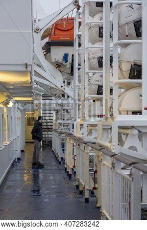 Helsinki, Finland - January 16, 2020: A Man Walks Along The Deck Of A Gabriella Passenger Cruise Fer