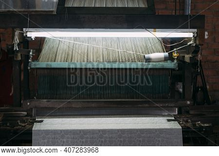 Close-up Of Old Silk Weaving Machine Running, Creating Silk Cloth In Vietnam.