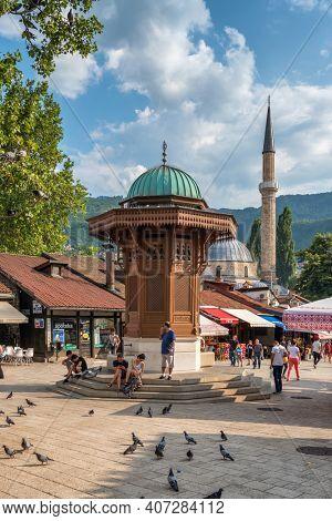 Sarajevo, BiH - August 28, 2019: Bascarsija square with Sebilj wooden fountain in Old Town Sarajevo in Bosnia and Herzegovina
