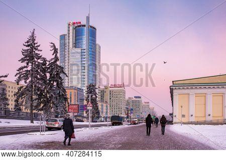 Minsk, Belarus - December 24, 2018: Victors Avenue or Prospekte Pobeditelei in central part of Minsk at sunset in winter, Belarus