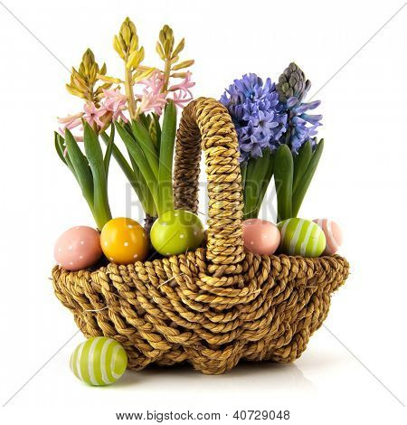 Basket spring hyacints in pink and blue and colorful easter eggs