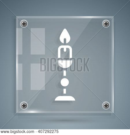 White Burning Candle In Candlestick Icon Isolated On Grey Background. Old Fashioned Lit Candle. Cyli