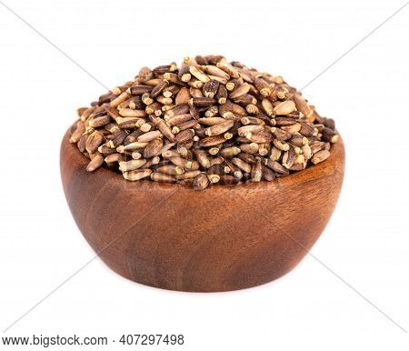 Milk Thistle Seed In Wooden Bowl, Isolated On White Background. Silybum Marianum, Scotch Thistle Or