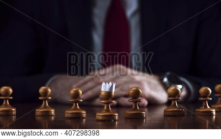 The Concept Of Strategy And Business Planning, A Businessman At A Chessboard In Front Of Lined Up Wh
