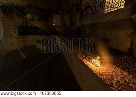 A Menorah Is Lit In A Park In The Jewish Quarter Of Jerusalem's Old City, Israel (to The Editor - On