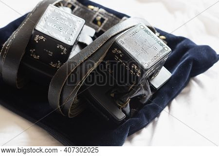 Tefillin With A Plastic Case, Folded And Placed On A Velvet Pocket, (to The Editor: In Hebrew - Head