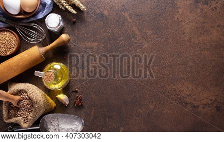 Bakery ingredients for homemade bread baking on table. Recipe concept  at stone background as panorama or panoramic top view texture with copy space, flat lay