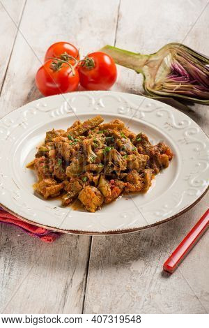 veal stew with hartichoke and tomato sauce