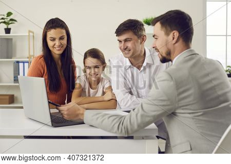 Happy Family Meeting With Real Estate Agent And Discussing House Purchase Details