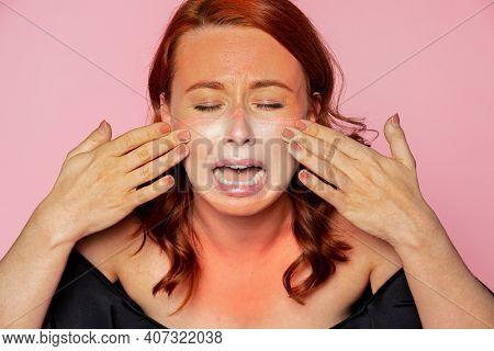 Face mask tan line on an upset woman's face