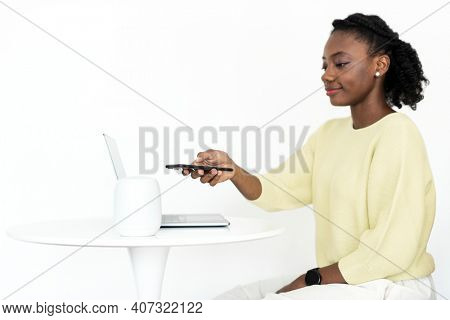 Woman connecting smart speaker to phone