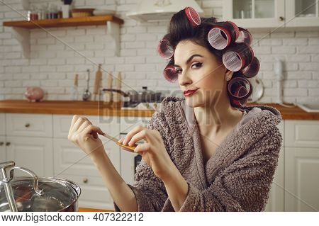 Young Wife Filing Her Nails, Scheming A Cunning Plan, Pondering Her Choices And Smirking