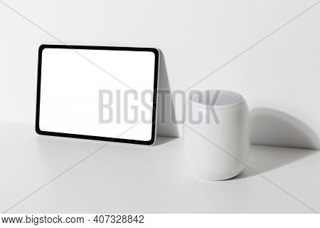 Digital tablet by the smart speaker