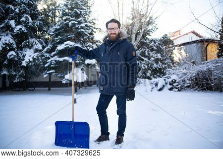 Man Standing With A Snow Shovel On Snow. Shoveling.