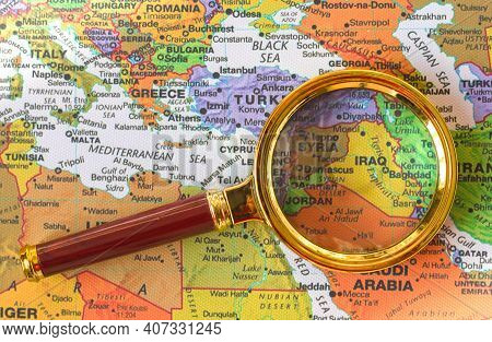 Lviv Ukraine-09 02 2021 :syria, Iraq A Map Of Asia In A Defocused Magnifying Glass, The Theme Of Tra