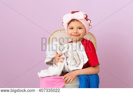 A Little Girl In A Red T-shirt And Curlers Keeps Her House Clean. Cleaning The House.