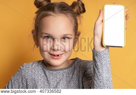 Close Up Portrait Of Happy Teen Girl Holding Phone And Showing Blank Screen Of Mobile Phone Looking