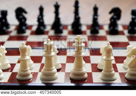 Close-up Of Chess Pieces Placed On Chessboard At Beginning Of The Game. Concept: Tactics, Preparatio