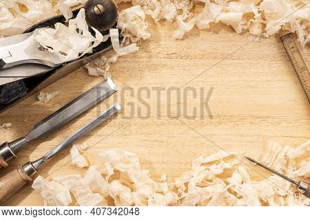Carpentry Or Woodworking Background With Copy Space. Old Carpentry Tools And Wood Shavings On A Work