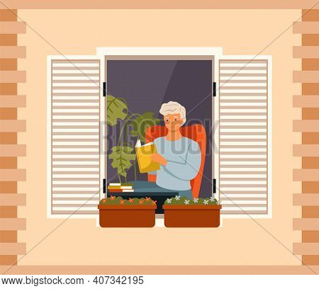 Man Is Reading Book On Balcony Of His House. Young Guy Sits In Armchair And Looks Out The Window. Ma