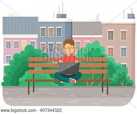 Boy In Yoga Pose Siting On The Bench In Park With Laptop, Works In Nature, Typing On The Keyboard. C